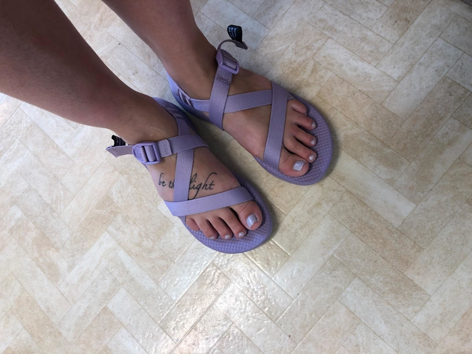 Model in the purple strappy Chaco flat sandals