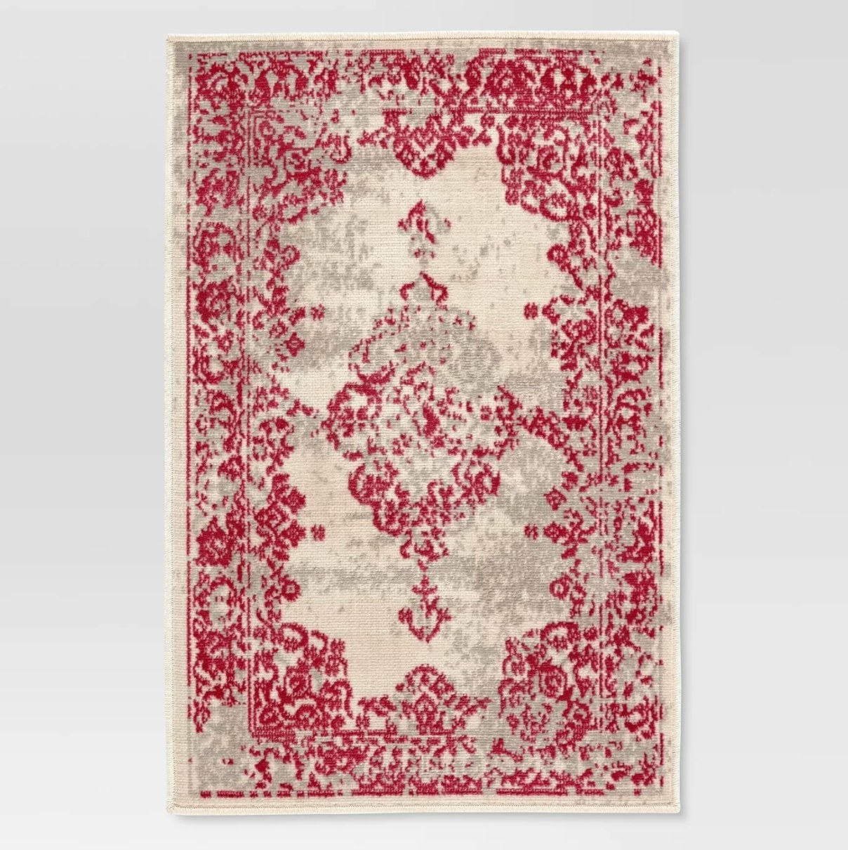 the red and cream ornate rug