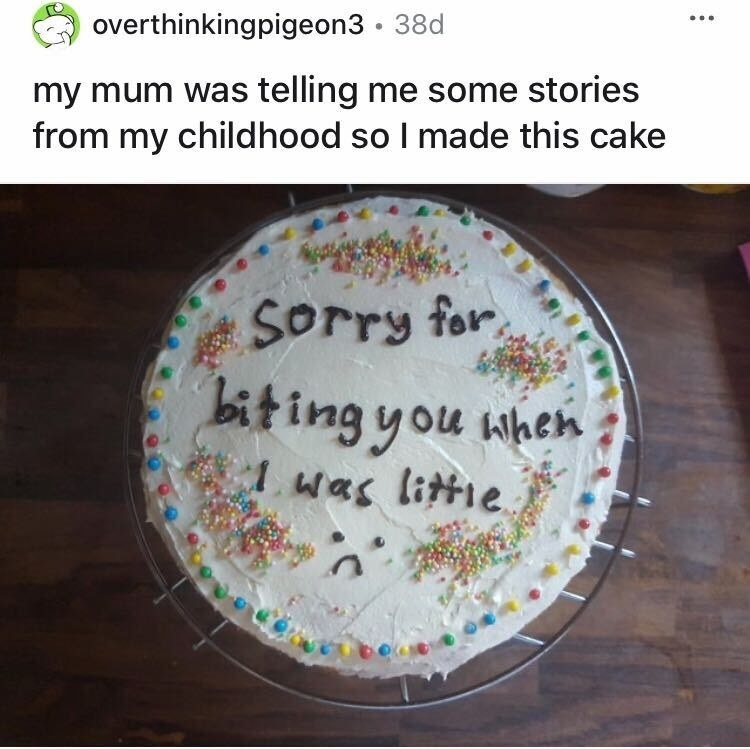 "A cake that says, ""Sorry for biting you when I was little"""