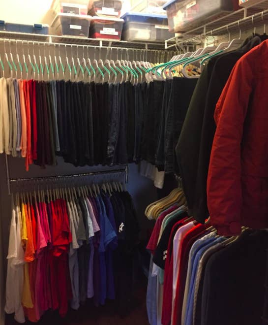 A customer review photo of the Simple Houseware adjustable closet hanging rod in chrome hanging in their closet