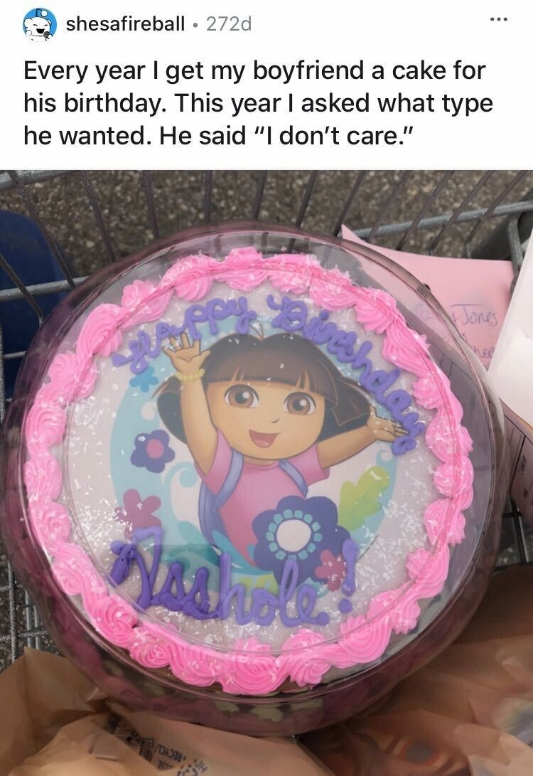 "A ""Dora the Explorer"" cake that says ""Happy Birthday Asshole"""