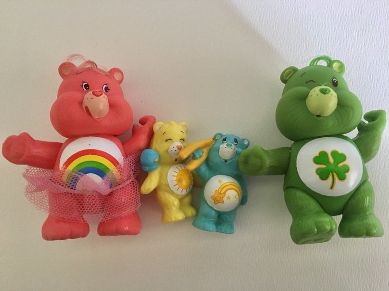 Four different PVC Care Bears figures.