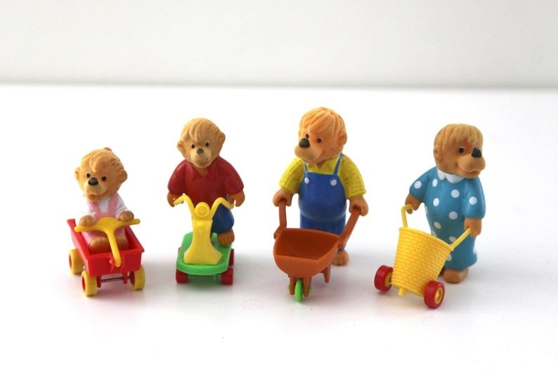 A four Berenstain Bears (Sister, Brother, Papa, and Mama) Happy Meal toys.