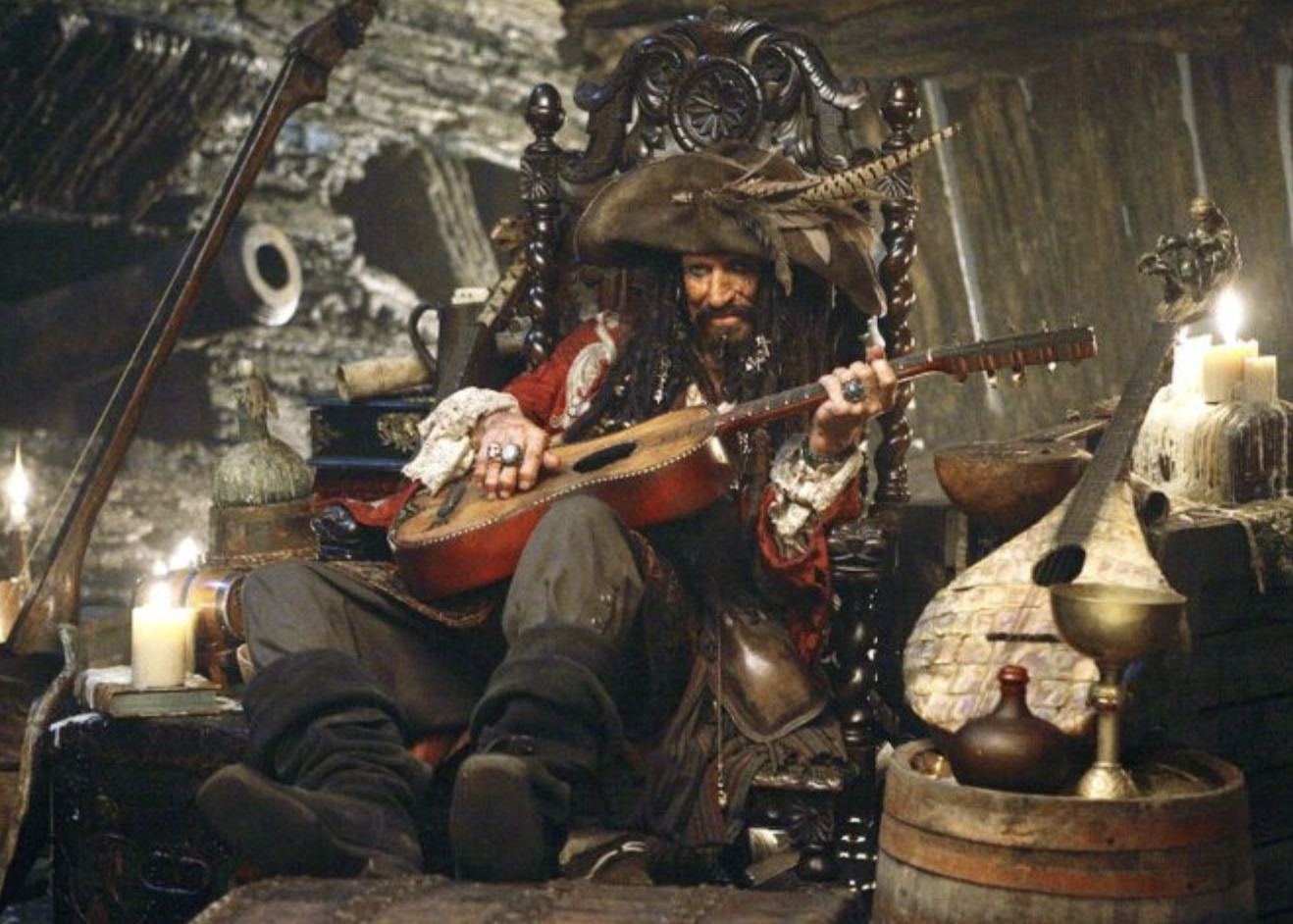 Keith Richards in pirate's garb strumming a guitar