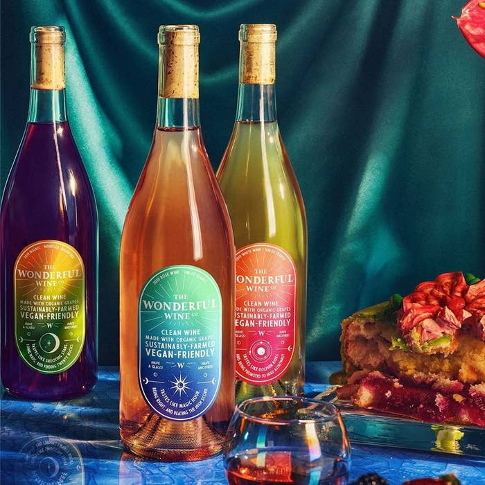 The three different kinds of wine in their glass bottles