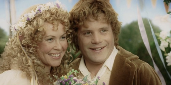 Sam and Rosie smiling at their wedding