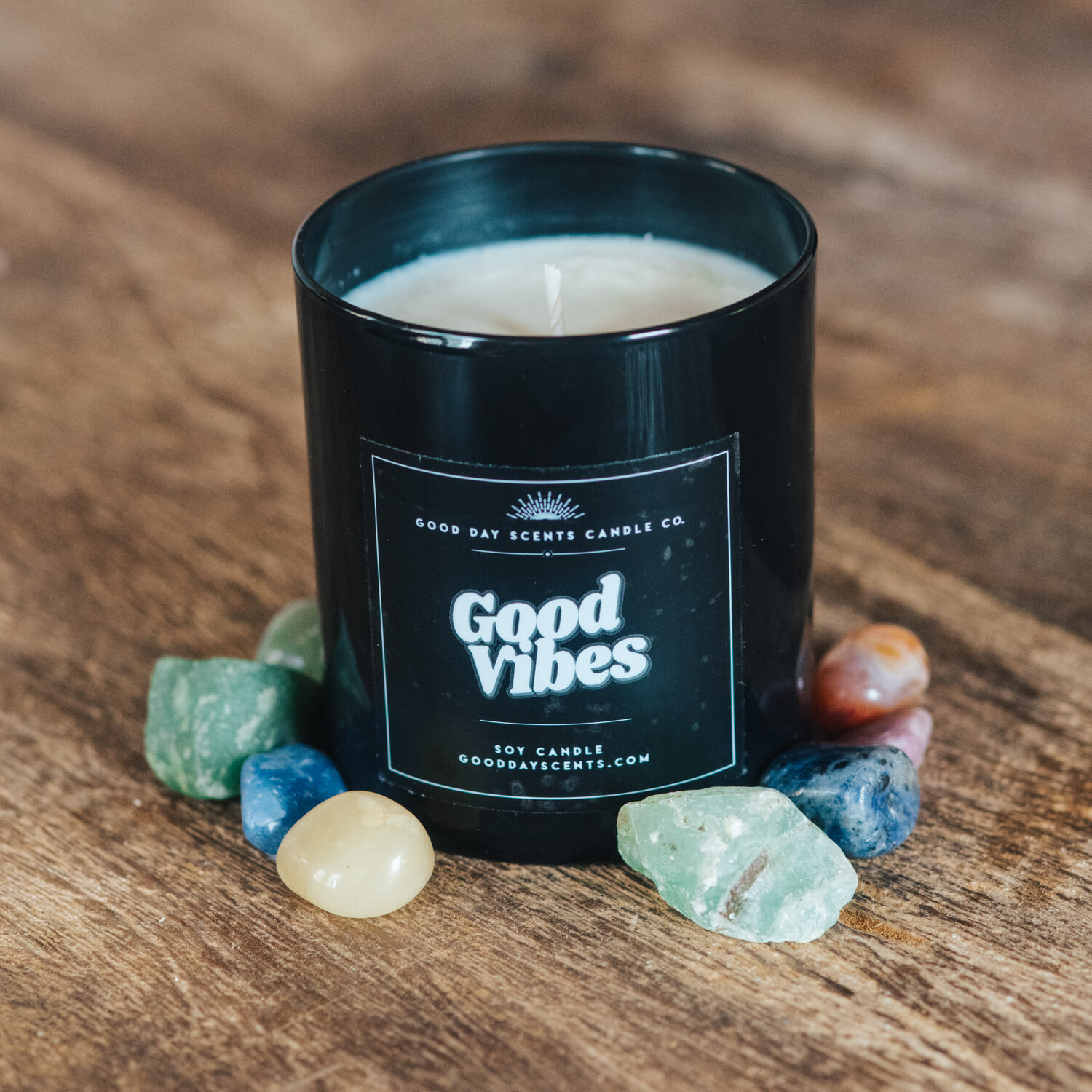 Candle in a minimalist black jar with the text good vibes printed on it