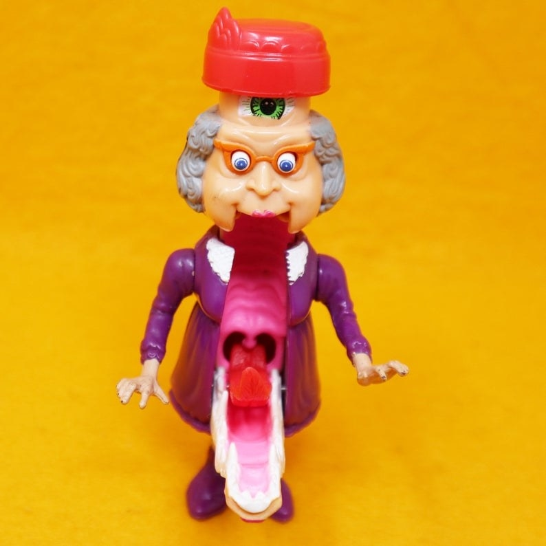 Granny Gross transformed into a screaming monster with a large mouth.