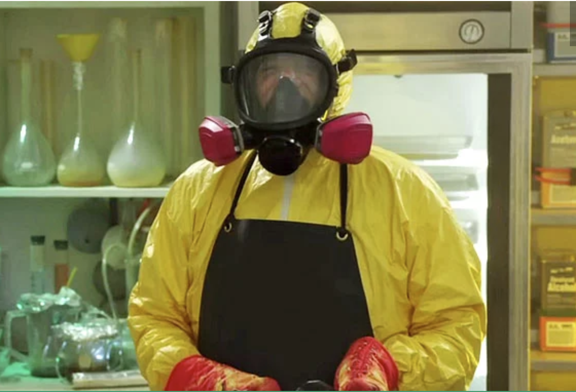 A man (Billy Murray) wearing a gas mask and plastic safety suit