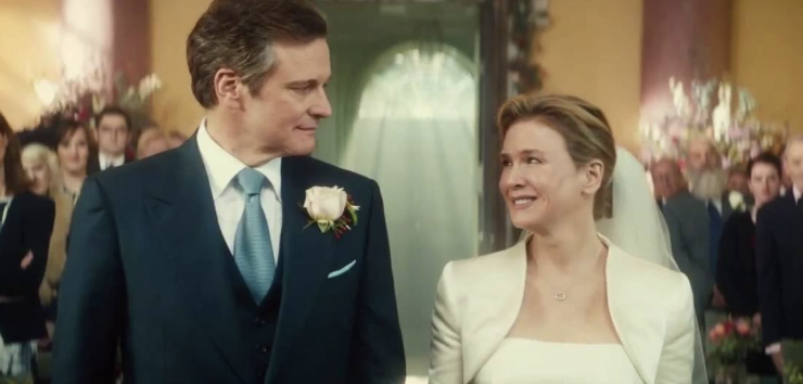 Mark and Bridget smiling at each other in their wedding outfits