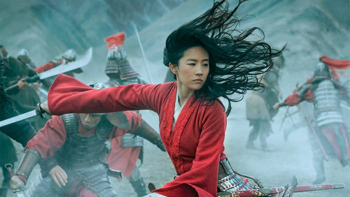Mulan fighting while in a battle