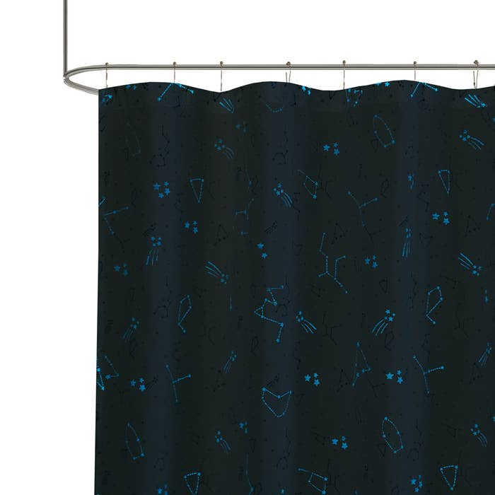 The dark blue shower curtain with zodiac constellations on it