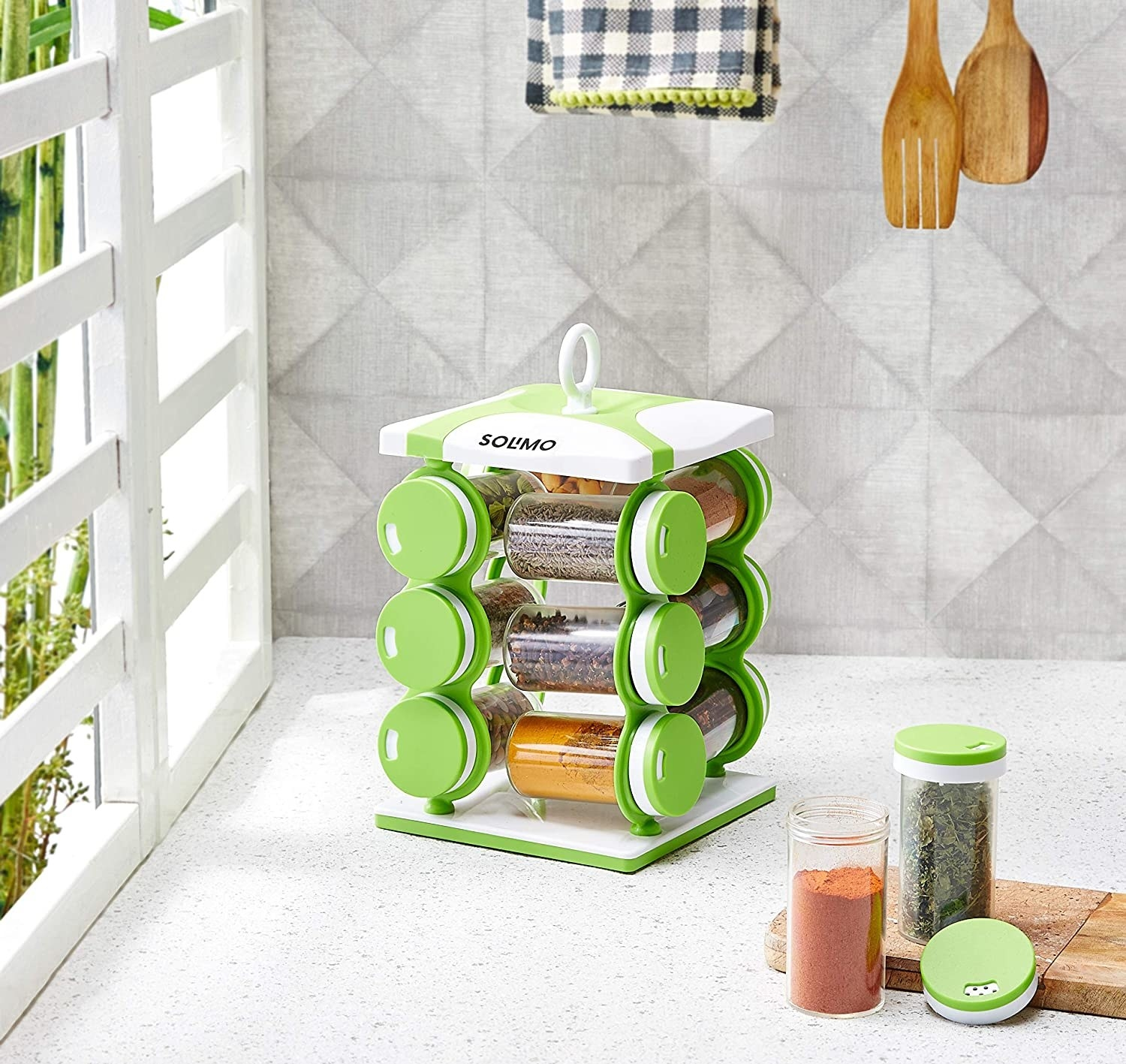 A rotating spice racks with spices in it