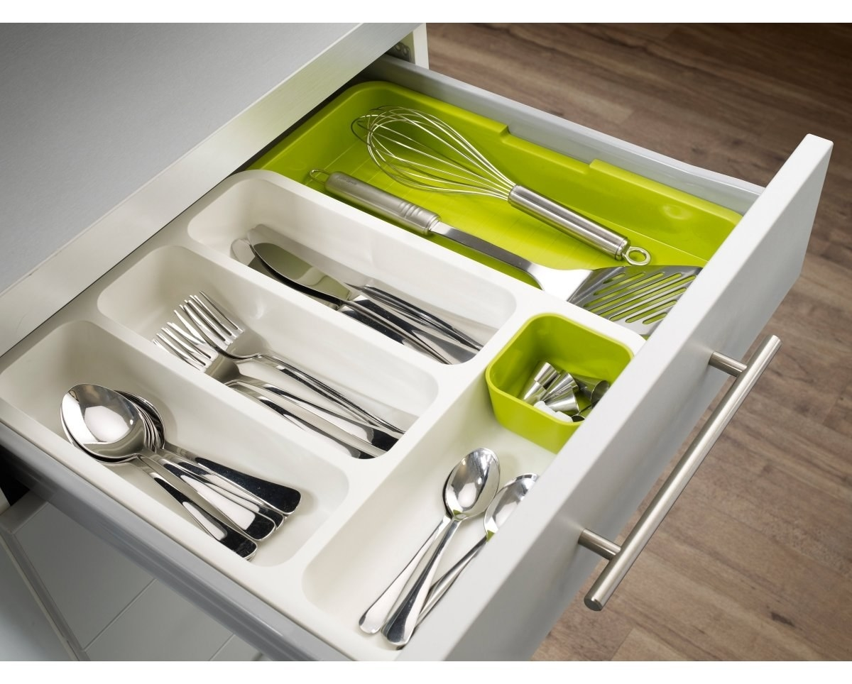 A green and white cutlery organiser