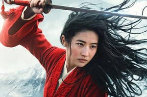 Mulan in a fighting stance. She is holding a sword above her head, ready to strike