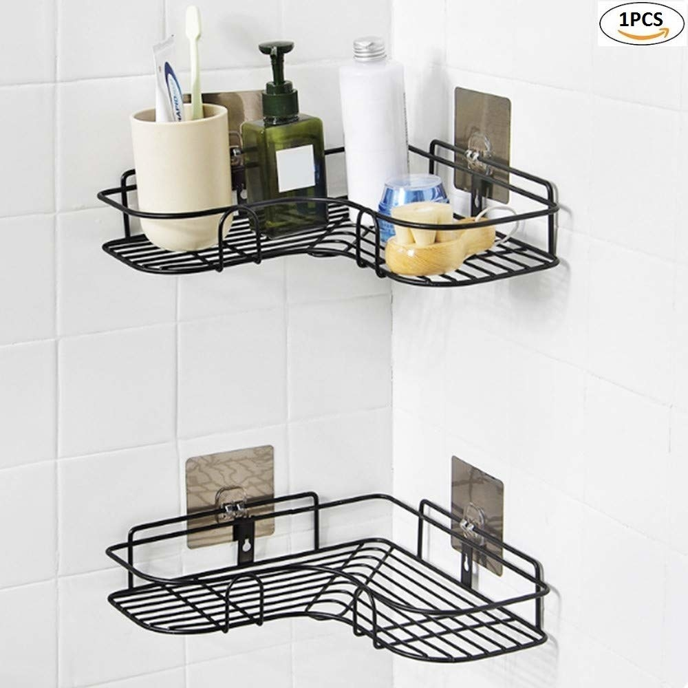 A black wall-mounted toiletries organiser