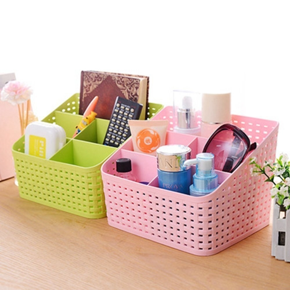 A green and pink organiser with items in them