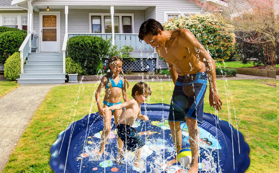 Kids and an adult play in a splash pad in a backyard