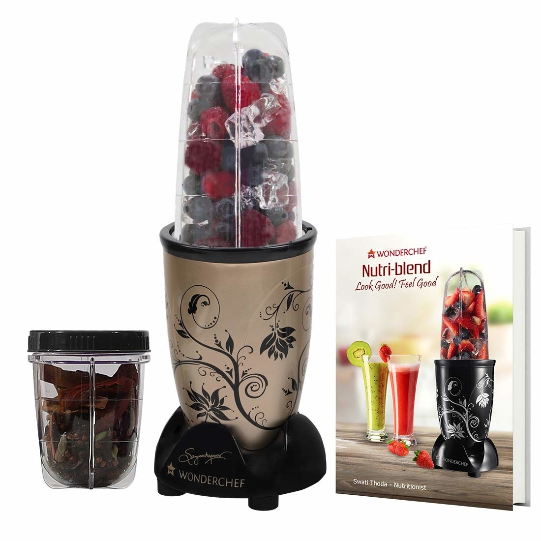 The Nutri-blend pictured with fruits in the blender jar and whole spices in the small grinder jar.