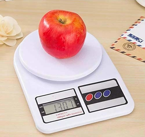 The digital kitchen scale pictured with an apple on it.