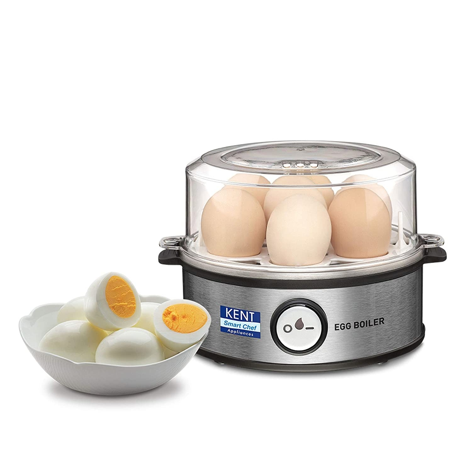 The egg boiler pictured with eggs in it, next to a bowl of boiled and peeled eggs.