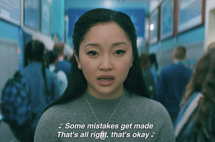 """Lara Jean singing """"Some mistakes get made, that's all right, that's okay"""" in the school hallway"""