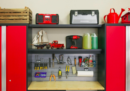 Red garage organizing system with tools and a radio