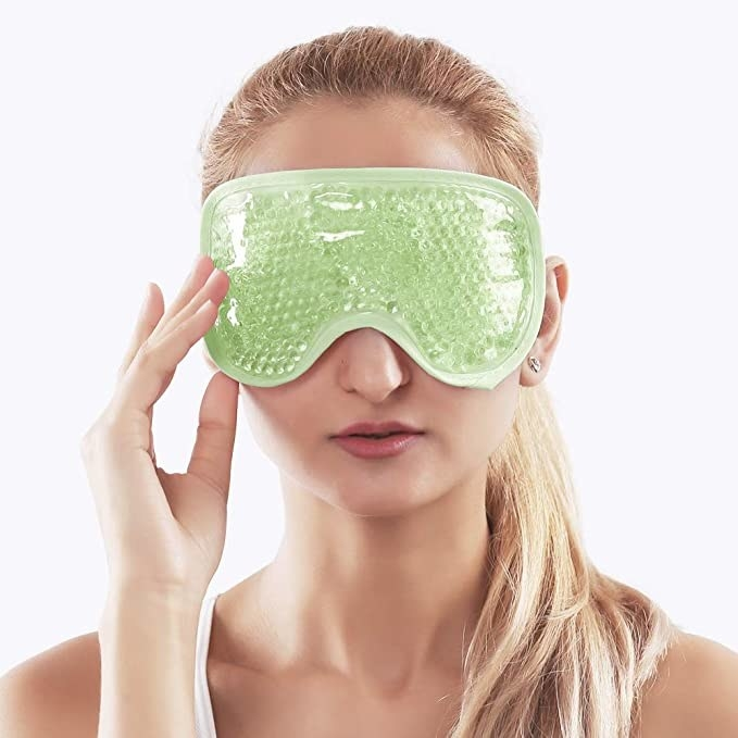 A person wears the mask over their eyes