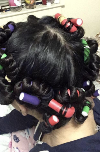 Reviewer using the foam rods in hair