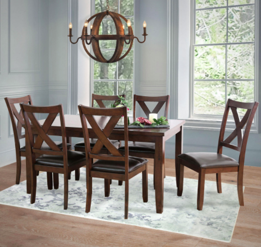 Wooden 7-piece dining set with flowers on top near large windows