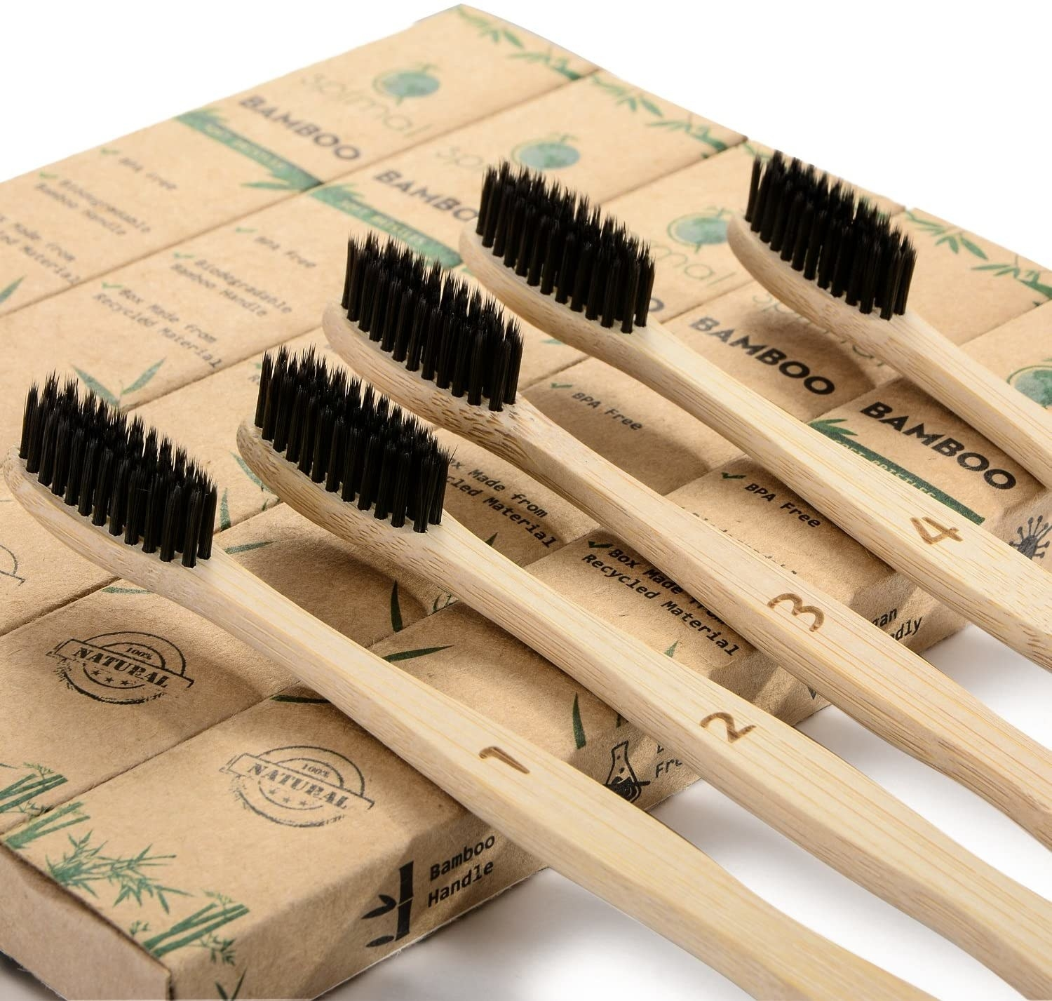 A close up of the five bamboo toothbrushes with charcoal infused bristles
