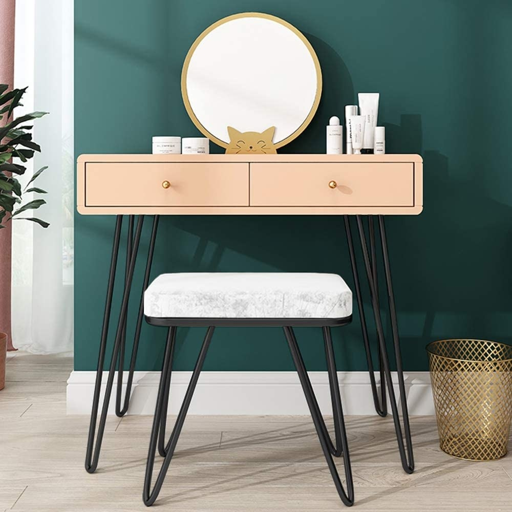 The hairpin table legs on a vanity and stool set