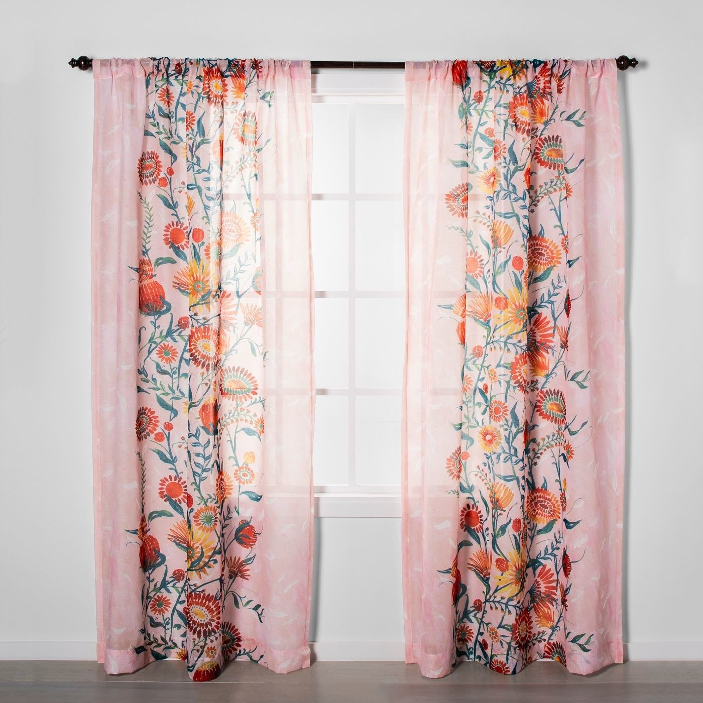 Sheer curtains in pink with multi-color floral pattern down the middle