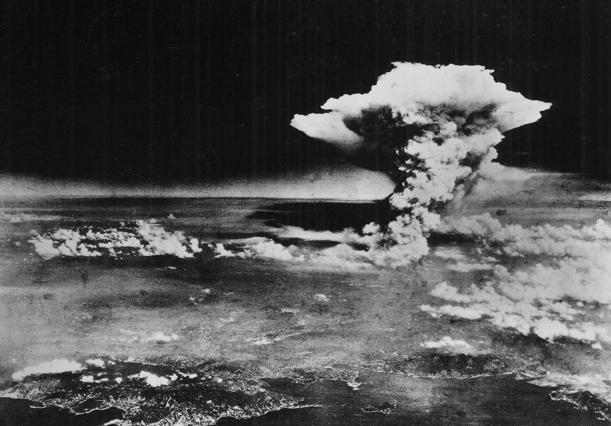A mushroom cloud seen from the air over the city of Hiroshima
