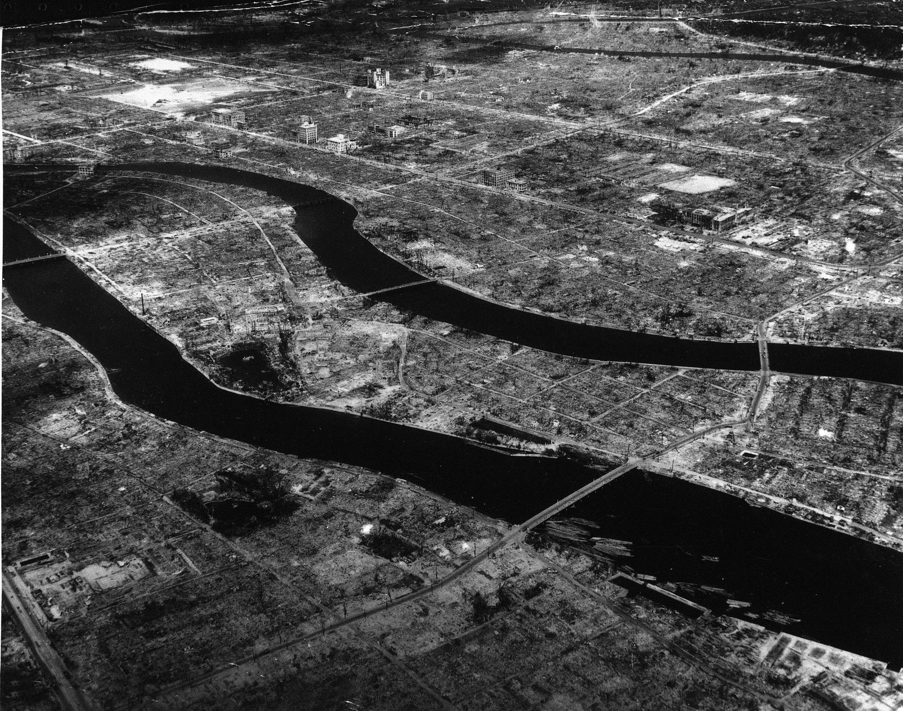 Two rivers cut through a desolate landscape where a city once stood.