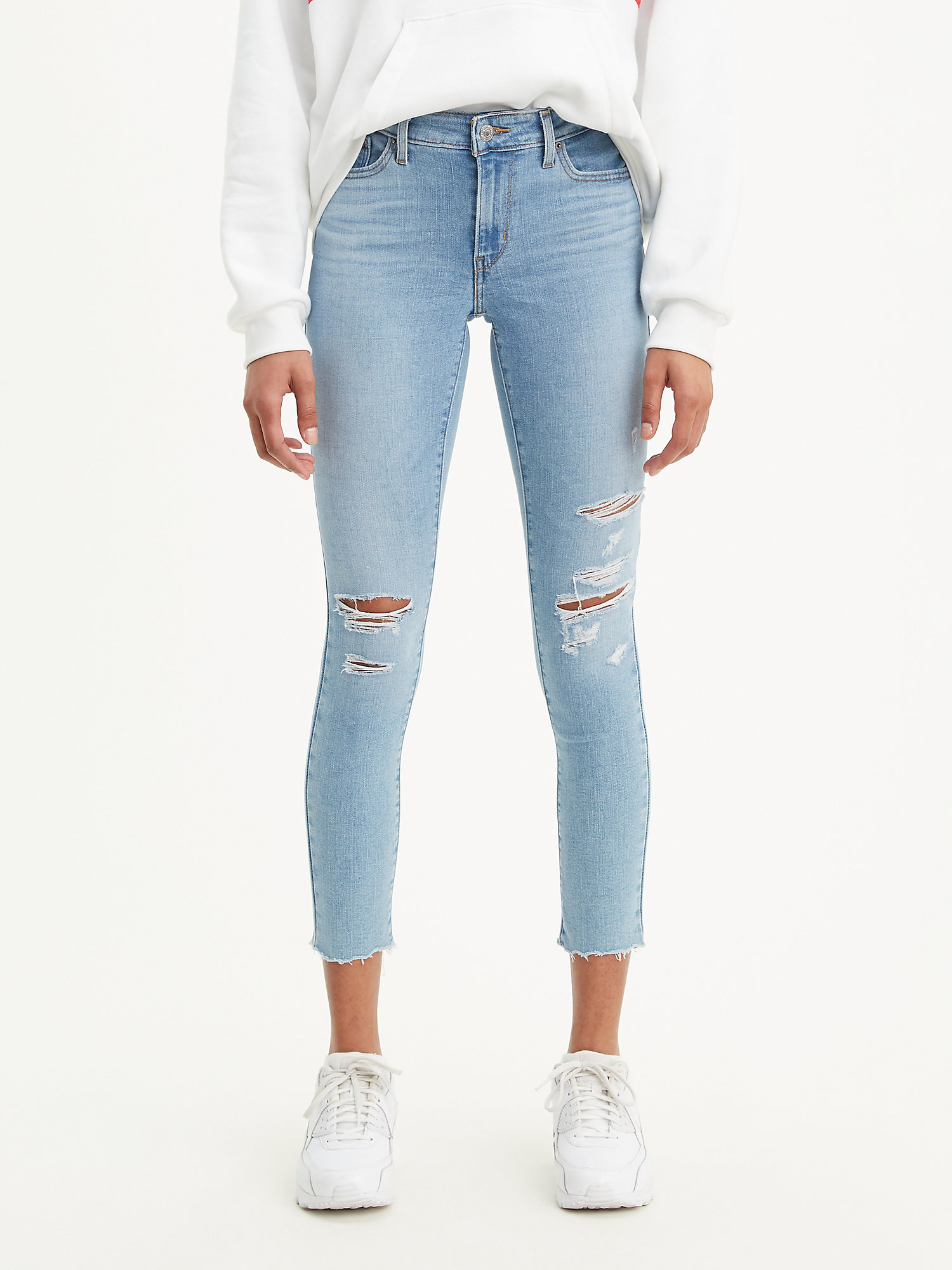 the jeans with distress marks throughout