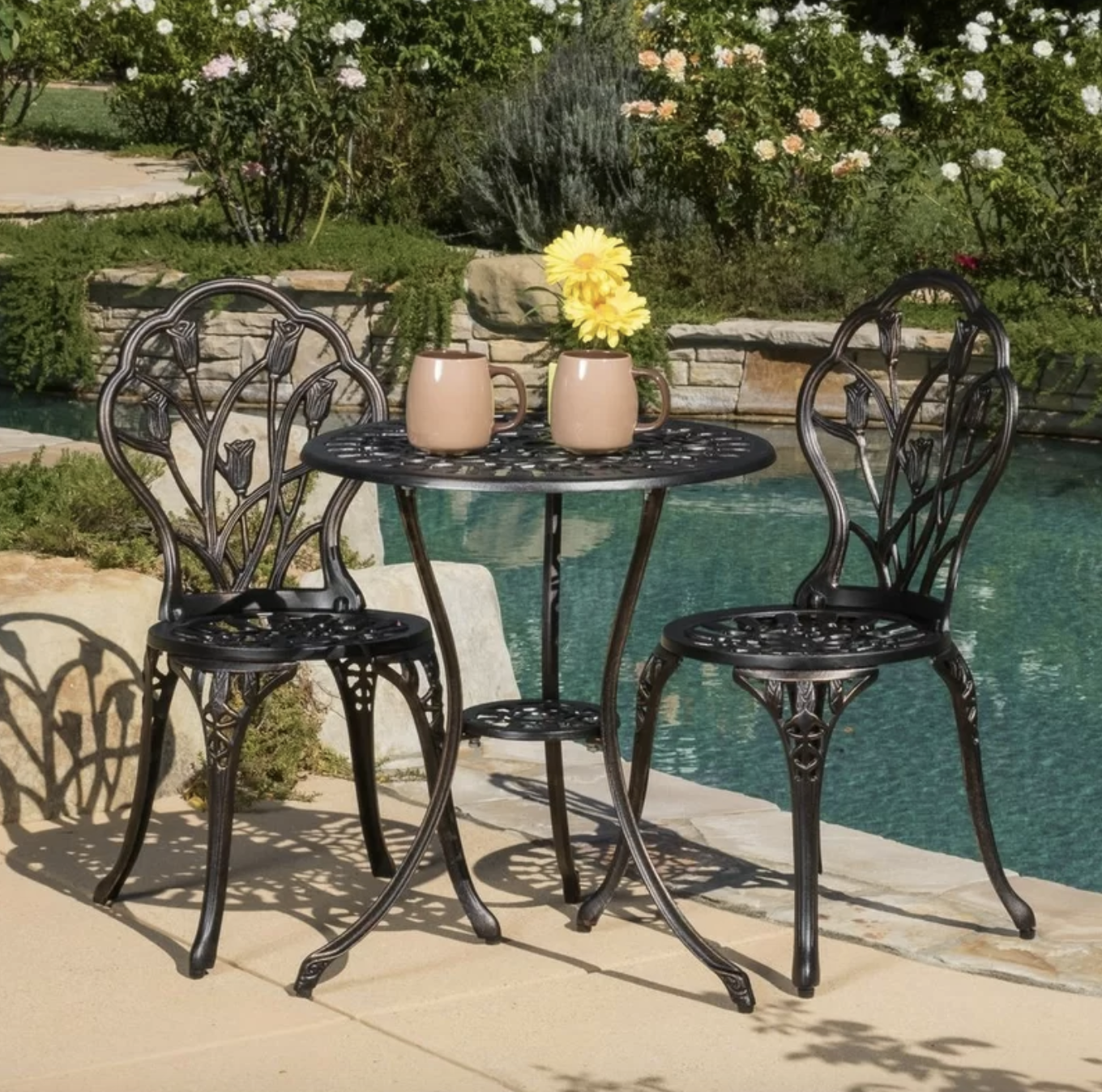 The bronze bistro table and two chairs with a tulip design