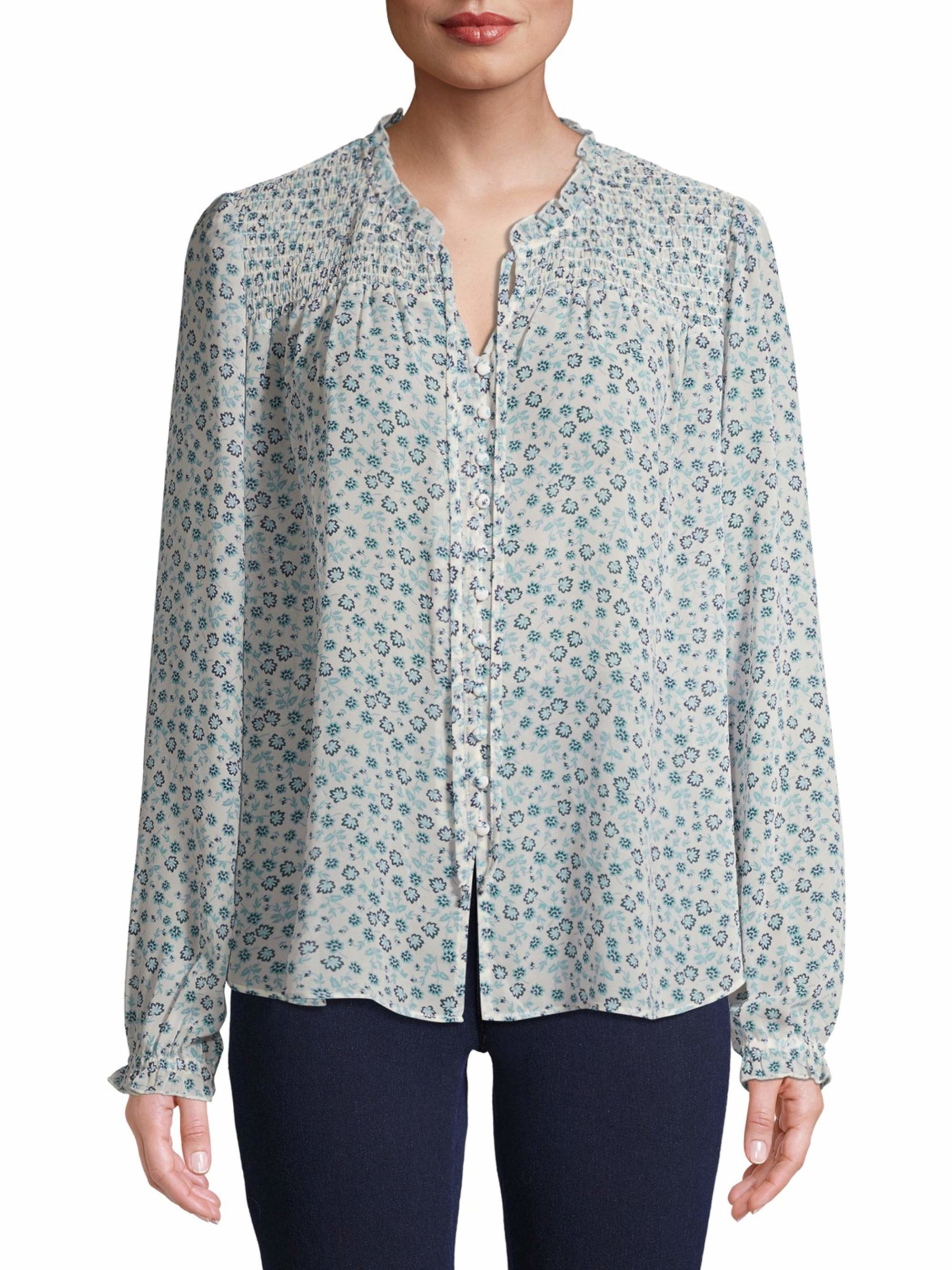 the shirt in white with blue small florals all over it