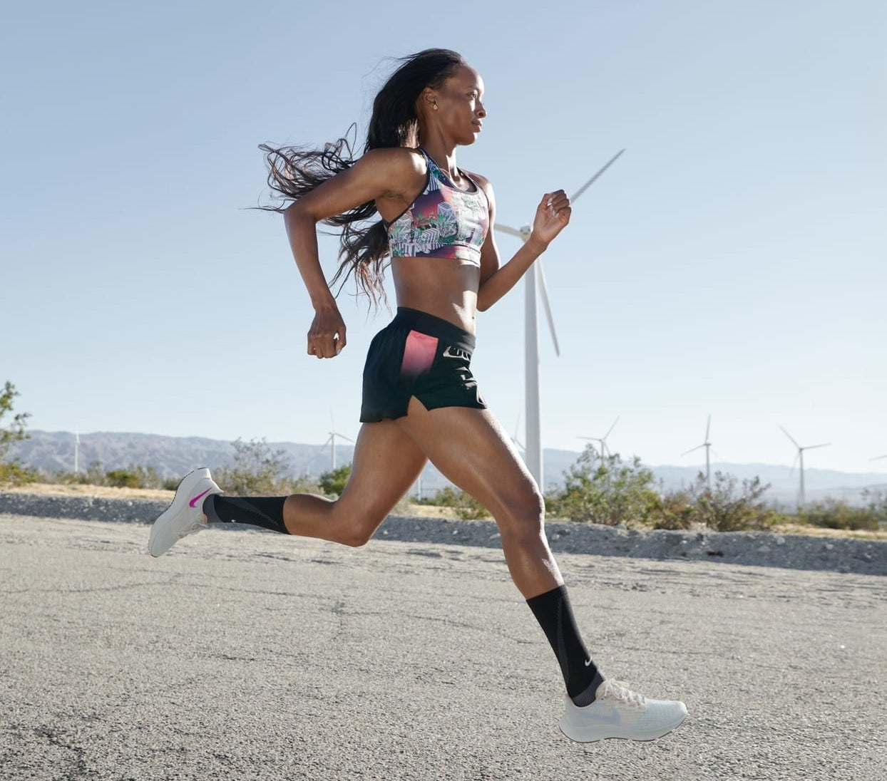 Model running in the lace-up sneakers
