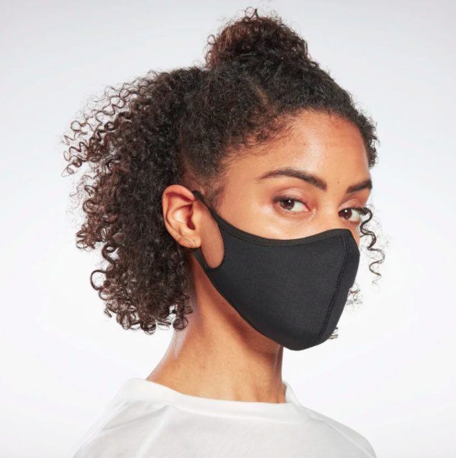 A model wearing the Reebok face covering.