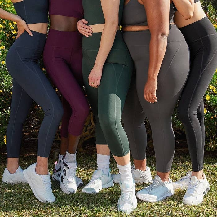 Models with different body types wearing the leggings in different colors