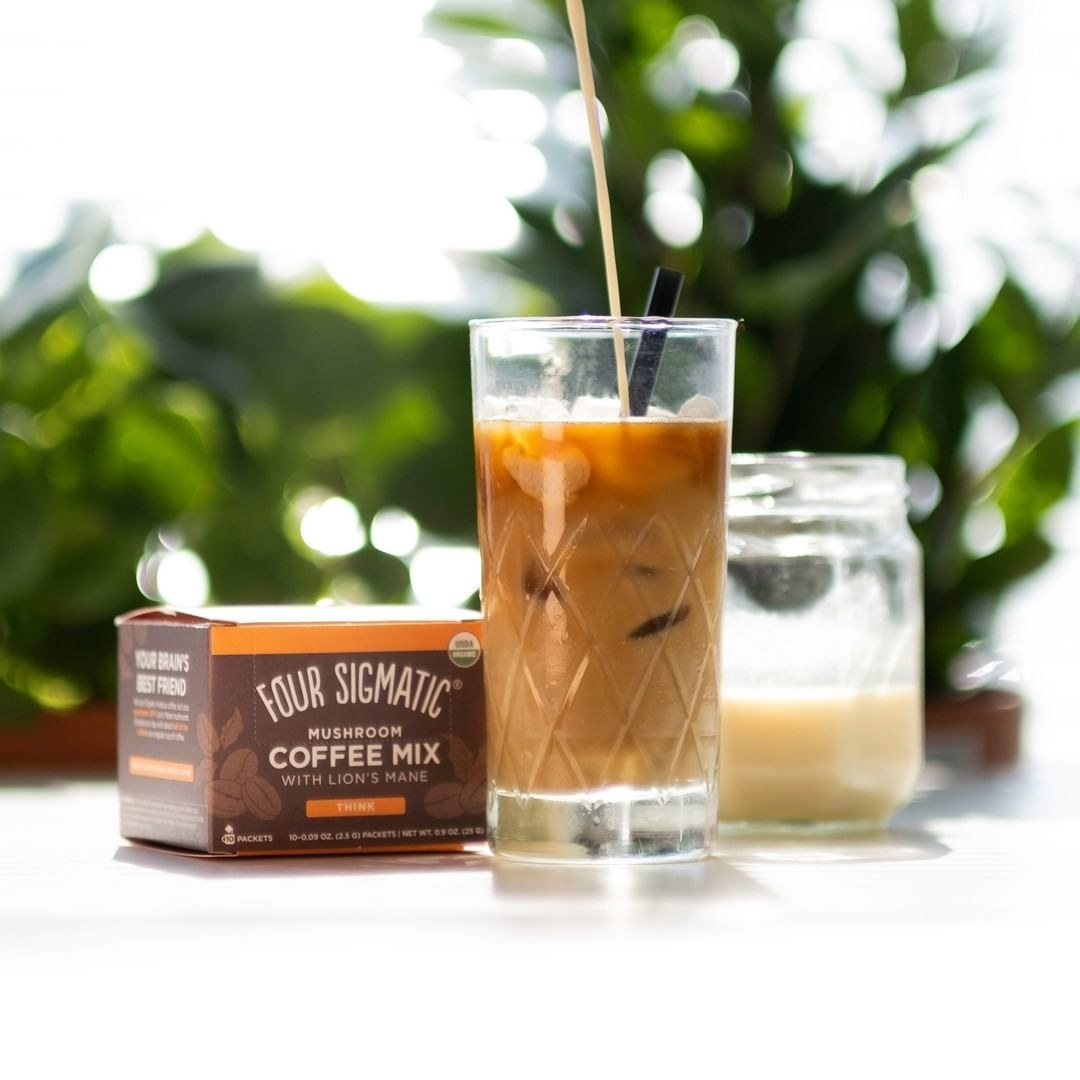iced coffee next to box of instant powdered coffee