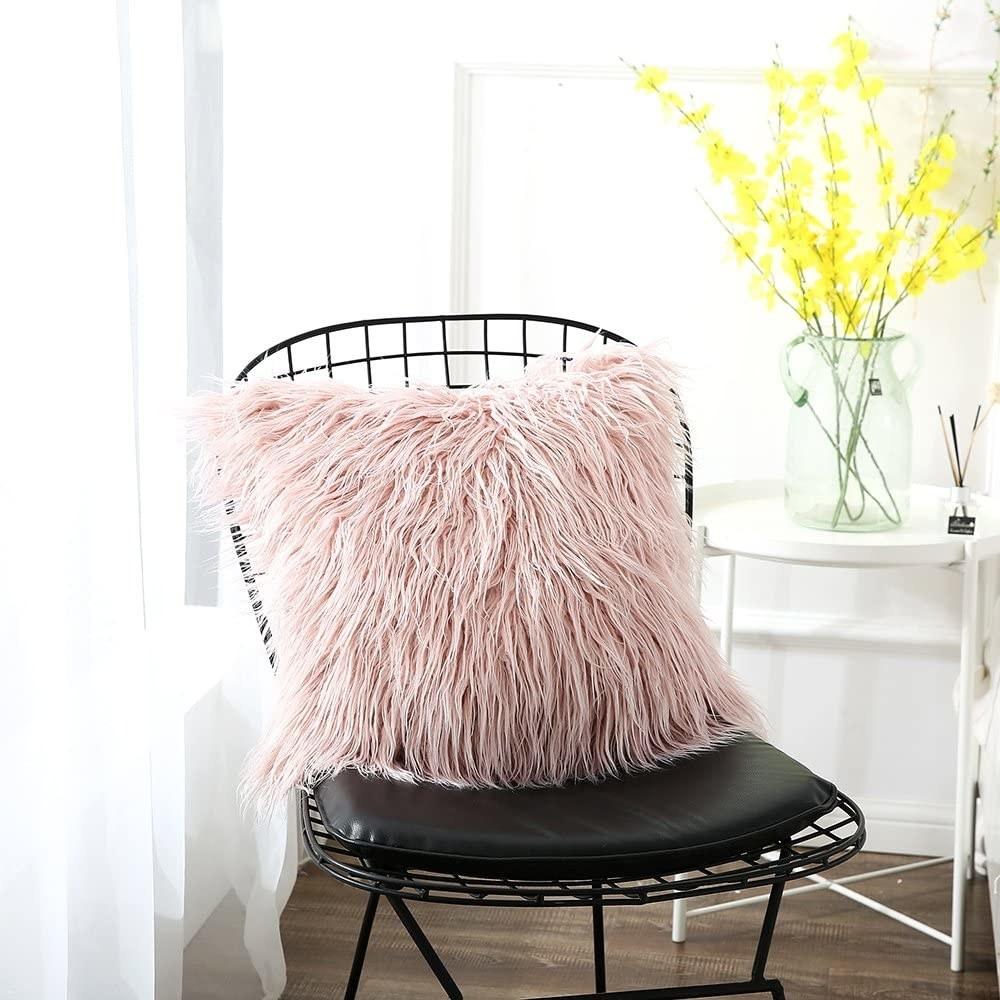 A faux fur pillow on an office chair