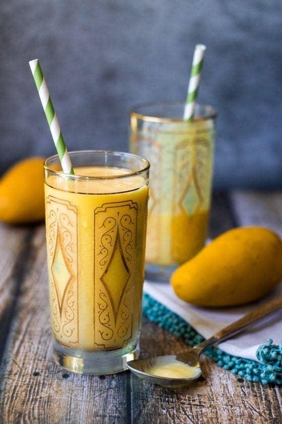 Image of two glasses of mango lassi