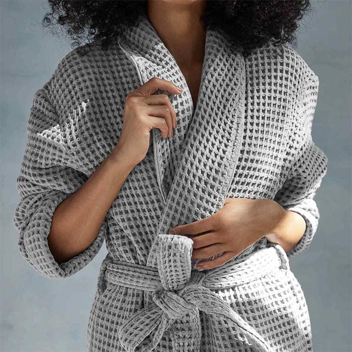 model wears grey robe