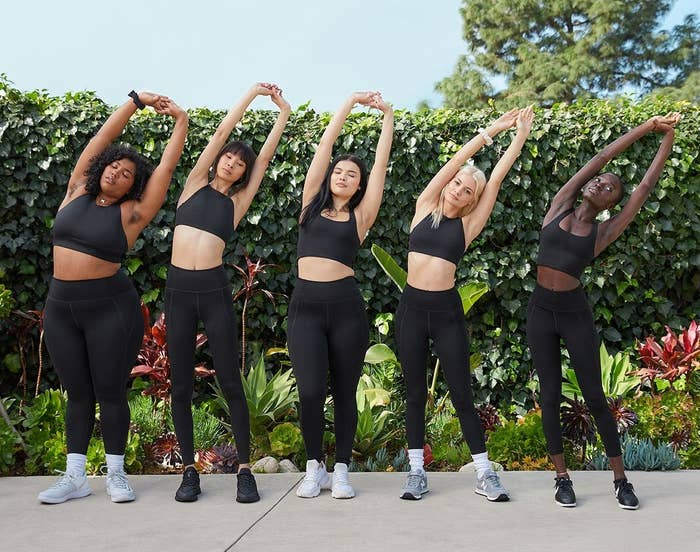 Lineup of models of different sizes and skin tones wearing the leggings