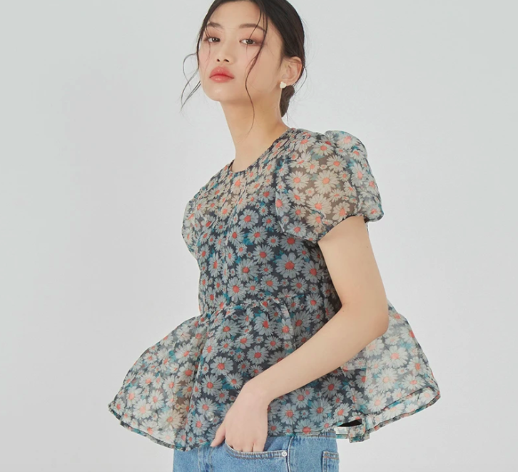 A model wearing the sheer puff sleeve blouse.