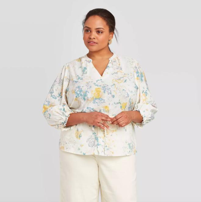 A model wearing the tie-waist blouse.