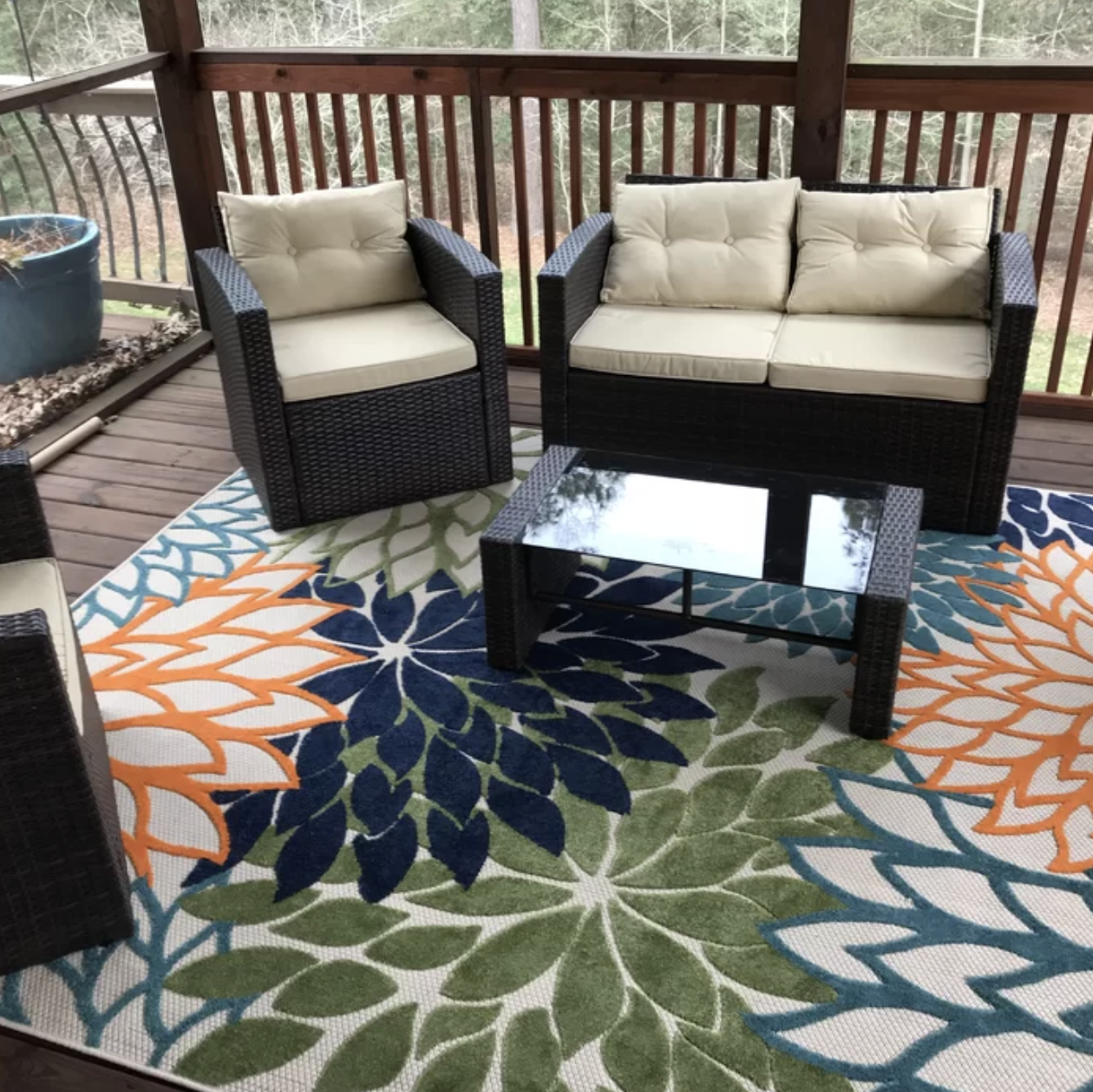 Reviewer's photo of the floral rug on their deck