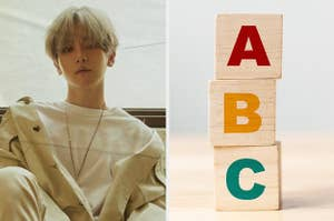 Baekhyun looks into the camera next to an image of three blocks stacked on top of each other with letters on them